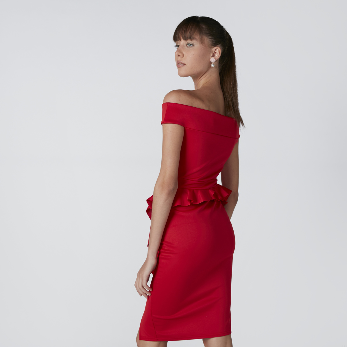 Woman in red off-shoulder peplum dress